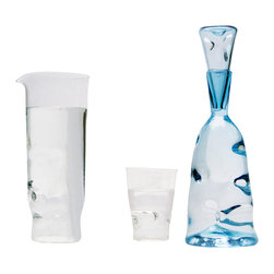 Esque - Dent Collection Pitcher, Light Blue - Make an impression with this handmade art glass pitcher. High-quality glass in clear or light blue is handblown and impressed with small dents for extra texture and one-of-a-kind appeal. Pick a great piece to complement your own set — or get the whole collection.
