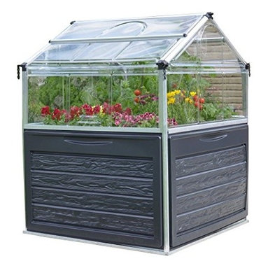 """Poly-Tex, Inc. - Plant Inn Raised Garden Bed Greenhouse - Plant Inn Raised Garden greenhouse is the perfect place for growing in small spaces. The Plant Inn is 46"""" x 46"""" and the raised beds are 28"""" off the ground and make gardening accessible to everyone. The peak is 58 1/2"""" high and has two lids for easy access and temperature control. The lids can lock open for either full access to do your planting and harvesting or partially for ventilation. The unbreakable polycarbonate panels also help protect your plants from pests and cold. Includes two 6 1/2"""" deep planting areas, internal water drainage and plant hangers for trellising. The Plant Inn has a built in storage space under the trays for all of your gardening tools and accessories."""
