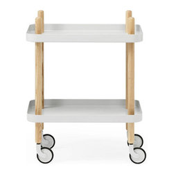 Peggy Cart Table in White - From its peg legs that extend into handles to its cheery, bright white shelves, this useful wheeled table exudes retro charm. Roll it from room to room for use as a nightstand, side table, bar cart, printer cart, and many other great options.