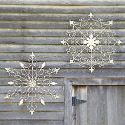 Iron Snowflake Decorations - I love having holiday decor that isn't 100 percent Christmas, like these iron snowflakes. That way, I can leave them up all winter long.
