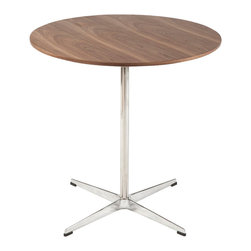 Round walnut cafe dining table - The Gennep dining table provides a large round surface with a rich walnut veneer. The table top is supported by a stainless steel frame with a polished aluminum base.
