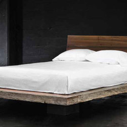 Liz Queen Platform Bed - A beautiful collection of sustainable bedroom furniture that is hand-crafted from exotic demolition hardwoods such as salvaged wood from downed telephone poles and from 100-year-old flooring as well as white oak and black walnut. Handcrafted with natural wax finish. This beautiful work of art combines contemporary design with old, reclaimed wood to make a unique, eco-friendly statement