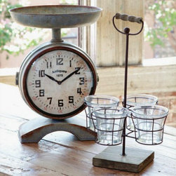 """Double Sided Scale Clock - A charming display piece for your kitchen island or counter top, this vintage inspired scale clock boasts a functioning clock on both sides and serves as an attractive display for fruits and vegetables. Battery operated and measures 10""""W x 14""""H"""