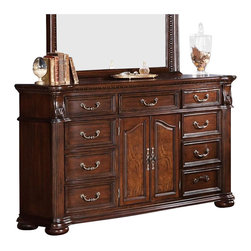 Coaster - Coaster DuBarry Dresser in Rich Brown Finish - Coaster - Dressers - 201823 - Give your master suite stylish storage space with this dresser from the DuBarry collection. Crafted from mahogany solids and veneers, this dresser features nine drawers and two doors, providing you with plenty of space to keep clothes, linens, and shoes tidily tucked away. A rich brown finish helps highlight the traditional splendor of this dresser, such as the breakfront molding, reeded pillars, and classic bun feet. Dovetail drawer construction and full extension glides provide you with a strong storage space that will function with ease, while felt-lined top drawers provide you with a safe place to store jewelry or treasured keepsakes. Complete with accent metal hardware, no master suite should be without the sumptuous style and storage this dresser has to offer. Finish the look with added height and light by pairing it with the coordinating mirror, also from the DuBarry collection.