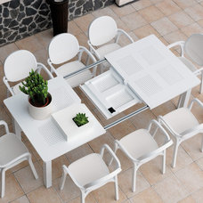 Contemporary Outdoor Dining Tables by CozyDays