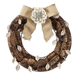 Home Decorators Collection - Round Pinecone Wreath - Add our charming Round Pinecone Wreath to your holiday wall decor. The round wire frame holds a bounty of pinecones decorated to appear as if fresh snow has just fallen. Small metal leaves, a large burlap bow and a crocheted snowflake embellishment complete this rustic, homespun look. Crafted with real pinecones. Wire frame. Not for use outdoors.