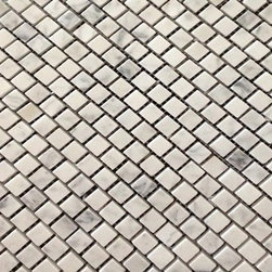 "Honed Carrara 1/2"" x 1/2"" Offset Squares on 12"" x 12"" mesh Tile - Honed Carrara Marble Mosaic Tile.  This marble mosaic tile provides a number of design possibilities from contemporary to classic. It can be used for both commercial and residential settings.  We recommend it for kitchen backsplashes, bathroom floors and walls as well as wet areas (i.e. shower floors and walls).  The mesh backing not only simplifies installation, it also allows the tiles to bend and seperate easily. The tiles have a polished finish. The natural material will have some color variation."