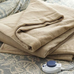 Plush Warming Electric Blanket, King/Cal. King, Taupe - Rest assured with this plush blanket. Its fiber and heating wires are ultrathin for supreme softness, and an automatic shutoff provides overheating protection. Made of polyester microfleece. Solid-state controllers. Easy-to-grasp knob with large, bright display which automatically dims itself in a dark room. Auto shutoff. Auto over-temperature regulation. Auto pre-heat and hold feature. UL listed. Imported.