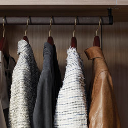 Leather wrapped hanging pole - Leather-wrapped poles give this closet a more luxurious look and feel.