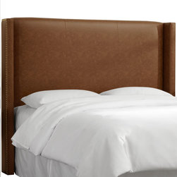 Skyline Furniture MFG. - Seamed Nail Button Wingback Headboard in Sonoran Saddle Brown - Create a sleek and sophisticated look for your bedroom with this fashionable nail button wingback headboard.  Featured in faux leather, the wings are embellished with an individual nail button trim.  It's constructed with plush foam padding for added comfort.  Attaches to any standard bed frame.  Handmade in the USA.  Spot clean only.
