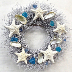 Frontgate - Ocean Shores Dried Wreath - Crafted of white-washed quail brush twigs, starfish, mother pearl shells, blue sea glass. Suitable for indoor or outdoor use in a covered area. Terrific for a door, wall, beach party, ocean-side wedding. Add an instant coastal feel to your entryway with the effervescent Ocean Shores Dried Wreath. Inspired by the beautiful sea, this organic wreath features quail brush twigs topped with supple starfish, radiant mother of pearl shells and gorgeous blue sea glass.  .  .  . Made in the USA.