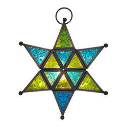 Zeckos - Blue / Green Stained Glass Six Pointed Star Hanging Tea Light Lantern - This beautiful stained glass six-pointed star shaped hanging lantern is a beautiful accent piece that looks great indoors or outdoors. The pieces of blue and green textured glass sparkle brightly when a lit tea light candle is set inside. The glass is held in place with matte finished metal, and openings in the sides allow access to the candle holder. A metal O ring allows you to hang the lantern from chains and hooks. The lantern measures 9 1/2 inches in diameter, and is 3 1/2 inches thick. It makes a great gift.