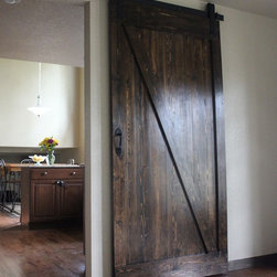 Barn Door Designs - The Framed Z Barn Door is a Tri-Lakes Artifex signature style that is rustic in appearance, but still promotes a modern aesthetic.  Small details such as plugged screw holes on the door front itself and smaller sized vertical stiles with the prominent diagonal rail, give a sense of country living even while surviving in an urban jungle.
