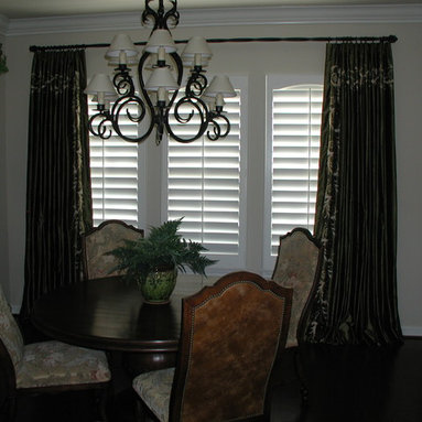 Custom Draperies - Embroidered silk taffeta side panels installed on twisted wrought iron pole with rings to frame shutters. Draperies puddled at the floor.