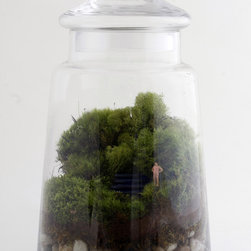 Take a Dip Terrarium - Terrariums are a current darling amongst home decor enthusiasts, and who wouldn't want a splash of green brightening up their interior? Twig steps up the whimsy by adding an unexpected miniature figurine to their already lush flora environs.