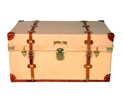 Leather Steamer Trunk - Recovered, embossed vegetable tanned steamer trunk with tan, hand-cut and riveted corner guards.