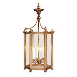 "Inviting Home - Hexagonal Brass Lantern - Six-light solid brass lantern 16"" x 14-1/4"" x 32-1/4""H Hand-crafted from solid brass six-light hexagonal lantern. Lantern has an antiqued finish and beveled glass panels. Lantern design features six ribbed columns with Corinthian capitals rising leaf trim and twisted rope motif. Brass lantern is electrified and designed for candelabra bulbs max.60 watts each bulb."
