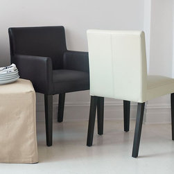 Porter Leather Dining Chairs - Supremely soft and supple leather makes this the low-key luxe version of one of our most popular chairs. Endlessly versatile, the chair's neatly tailored look and timeless lines combine to create generous comfort for the dining room and beyond.