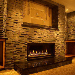 Muskego, WI - Full custom stone and fireplace project. Kozy Heat Slayton 42 installed with thin, dry-stack stone surround and into cabinets. Future TV above in Rec-room. Rich Jr.