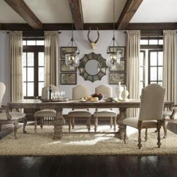Academy Rect Dining Table - Ease into brand new brilliance. Revitalizing traditional and glamorous designs, this extraordinary collection is built with natural hardwoods and veneers, infused with aged patina metal, clean linen upholstery, antique mirror and sculpted elements. Arm chair SKU#052642. Side chair SKU#052643.