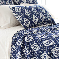 Varkala Indigo Quilt - The classic pairing of blue and white is reimagined in a diamond pattern that is at once playful and refined. Named after a beach in India, the Varkala Indigo Quilt is made of a soft and drapey lightweight cotton that imparts the airiness of a languid summer's day. The sham's reversible pattern is exclusive to its color combination.