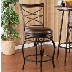"""Wildon Home � - Wellford Swivel Stool - Enrich your home with stylish convenience. The intricate details, intersected arcs, and curved legs of this stool yield a beautiful, timeless appearance. A powder-coated, dark champagne finish and durable steel frame deliver lasting quality. It features height seating, a cozy foam seat covered in rich dark brown vinyl, and a backrest accent in a rich walnut finish wood. A full 360 degree swivel and footrest ring provide comfort and ease. The detailed, curvaceous form and attractive finish coordinate with traditional to contemporary décor styles. Ideal for the kitchen, breakfast nook, bar, or dining area. The handcrafted touch of artisan skill also creates variations in color and design; slight differences should be expected. Features: -Champagne brown finish frame with rich walnut finish backrest and dark brown seat cushion. -Constructed of powder-coated steel, poplar, vinyl, particle board, and polyurethane foam. -Sturdy steel frame with luxurious vinyl seat and fire-retardant foam cushion. -Smooth 360 degree swivel. -Convenient footrest ring for ultimate comfort. -Curved backrest for optimum support. Dimensions: -Backrest: 17.75"""" H x 17.25"""" W. -Cushions thickness: 3"""". -24.75-in. Seat: 24.75"""" H x 16.75"""" Dia.. -24.75-in. Footrest height: 6.5"""". -30-in. Seat: 30"""" H x 16.75"""" Dia.. -30-in. Footrest height: 10.5"""". -24.75-in. Overall: 39.25"""" H x 20.75"""" W x 22.25"""" D, 28 lbs. -30-in. Overall: 44.25"""" H x 21.75"""" W x 22.75"""" D, 29 lbs . -Max weight capacity: 250 lbs."""