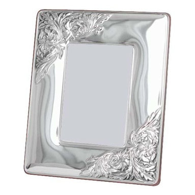 "Silverstar International - 3.5""x5"" Bijou II Silver Sterling Picture Frame - Personalize our Bijou silver wedding anniverary picture frame and create a personalized keepsake to treasure for a lifetime. Featuring a handcrafted embossed repousse sterling silver frame with an intricate floral motif embossed in the upper left and lower right corners, the Silverstar International bi-laminated 925 Sterling Silver picture frame is meticulously manufactured to an aluminum base for strength & attached to a veneer mahogany wooden back and easel. Every Silverstar picture frame is designed with a tarnish resistant surface for easy cleaning and glare resistant glass."