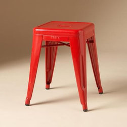 Tolix Pulup Stool - We use this piece as a nightstand next to a bed that is fairly low to the ground. It's a great industrial piece in the perfect, cheery red. Every day we are happy to see it!