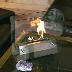 Bluworld Nu-Flame - Irradia Portable Tabletop Ethanol Fireplace - Modern in every sense of the word, Irradia is our most popular tabletop fireplace. A brushed stainless steel burner floats between two tempered glass panels, making the fire visible from every angle. The linear burner creates a ribbon of fire that dances and drifts, producing an almost hypnotic appearance. Irradia tabletop bio-fireplace is easily moved from room to room when not in use and may be used indoors or out, however do not leave your fireplace outside exposed to the elements after use. Ships with snuffer.  Fuel not included, we recommend using Nu-Flame Bio-Ethanol Fuel.Featuring:Tempered Glass for Safety.8 Lt. Capacity BurnerQuality Stainless Steel Burner Snuffer Tool Burns Clean Eco Friendly Bio-Ethanol Fuel 1 year warranty