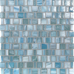 "Glass Tile Oasis - Heaven Shimmer 1"" x 1"" Blue Pool Glossy Glass - Sheet size:  1.12 Sq. Ft.    Tile Size:  1/2"" x 1"" & 1"" x 1""   Tiles per sheet:  192    Tile thickness:  1/4""   Grout Joints:  1/8""   Recycled Components:  0%   Sheet Mount: Paper Face    MADE TO ORDER-LEAD TIME 2 WEEKS     Sold by the sheet    - Brilliant transparent glass combed through with coordinating opaque colors  and featuring a contemporary smooth-edge. Each piece is hand-poured and unique  designed with a certain amount of variation and variegation of color  tone  texture and shade for a distinctive appearance. Our handmade process incorporates creases  wrinkles  waves  bubbles and other surface effects indicative of handmade glass  all designed to capture light and enhance the final beauty of the project."