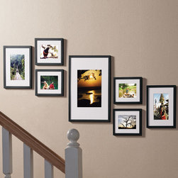 "Exposures - Staircase Picture Frame Set - Set Of 7 - Overview The staircase picture frame set is everything you need to create a perfect frame gallery up a staircase, without the guesswork! Decorate the wall youve been meaning to get to, but werent sure how to arrange, with this ingenious picture frame set. A true problem-solver, each value-priced solution includes seven wood frames, a hanging template (no more guessing at the right arrangement!) and hardware. Three frame colors are available to complement any dcor, including in-demand silver.  Features Seven wood photo frames Exposures quality at an incredible value  Beveled white mats Template for easy hanging included  Step-by-step guide included All hardware included Horizontal or vertical  Wall display only   Specifications  Seven-frame set includes 4  6"" x 8"" (4"" x 6"" opening), 2 8"" x 10"" (5"" x 7"" opening) and 1  12"" x 16"" (8"" x 10"" or 8"" x 12"" opening)"
