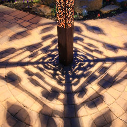 Attraction Lights overview - Aspen Obelisk (6x6x70 inches tall) shadow detail, natural rust finish.  Patterns with recommended LED lamp.  Photo by Lyle Braund