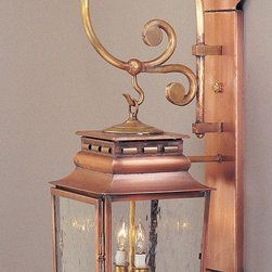 "Outdoor Lighting - French Provincial wall lantern with cast brass scroll wall bracket in antique copper, clear-seedy glass and 2 lights.  Size:9-1/2""W x 28-1/2""H, extends 13""."