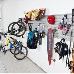 Flow Wall Sports and Recreation Storage System - About Flow Wall Put you workshop on the wall! We often hesitate to wall-mount equipment storage, because it's just so permanent. The innovative Flow Wall system changes all that, providing a simple system where shelves, hooks, cabinets, bins, and more simply switch places at will. By placing a custom-shaped Flow Wall where there was none, you've opened up a world of possibilities without locking yourself into one design. Perfect for the laundry room, rec room, garage, workshop, class room, craft area, and so much more, Flow Wall is the answer when your back's up against a wall.