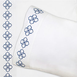 """Jonathan Adler - Jonathan Adler Hollywood Navy Sheet Set - The classic white sheet set gets a contemporary makeover as a mod floral stitch is embroidered in navy to accent the flat sheet and pillowcases. This graphic glam bedding design lives up to the """"happy chic"""" vibe of the Jonathan Adler tradition. Available in twin, full, queen and king; Includes flat sheet, fitted sheet and 2 pillowcases; 100% cotton percale, 400-thread count; Machine wash"""