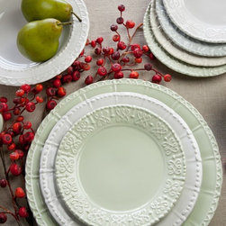 Historia Dinnerware - European history is repeated in this elegant dinnerware pattern from Skyros Designs. Each salad plate represents architectually inspired ironworks found in some of Europe's most enticing cities: Versailles, Milan, Vienna and Lisbon. Each salad plate is embossed with the name of the historic city. Historia is made of a fine, thin, stoneware that is chipresistant as well as being freezer, oven (to 500 degrees F), microwave and dishwasher safe! Enjoy the durability and soft color selection of Parchment, Paper White and Barely Blue that captures the incredible detailing throughout Historia.