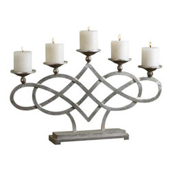 Uttermost Adala Silver Candleholder - Wrapped metal with a bright silver finish. Distressed white candles included. Wrapped metal with a bright silver finish. Distressed white candles included.