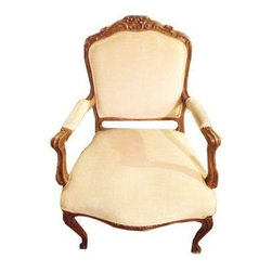Louis XIV Chairs in White Velvet - A Pair - Louis, Louis! This elegant pair of French Louis XIV style armchairs will add extra seating and a touch of chic to any room. Done in distress wood and upholstered in white velvet with padded arms and raised on tapering circular legs.