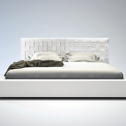 White Modern Woven Leather Madison Bed - Modloft Furniture - The Madison is elegantly designed with a complex woven leather headboard and simple leather frame. The leather headboard is hand woven featuring a sophisticated overlapping technique. Flexible wood slats sit inside the bed frame and allow air to circulate beneath the mattress. No box spring necessary; simply use an innerspring or latex foam mattress. Platform height measures 12 inches (2 inch inset). Available in California-King, Standard King, Queen, and Full sizes. Colors available include White, Plum, and Dusty Grey bonded leathers. Solid hardwood construction