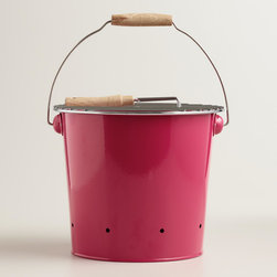 Mini Pink Galvanized Steel Bucket Grill - This may look like an ordinary metal pail, but it's actually a mini barbecue grill! It would be fun to put one on each table at an outdoor dinner party.