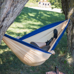 Island Bay - Island Bay Portable Hammock - PH-010-KB - Shop for Hammocks from Hayneedle.com! No if's and's or but's about it - the Island Bay Pocket Hammock - Khaki/Blue is an absolute must-have for the avid outdoorsman. Constructed of durable quick-to-dry nylon this hammock is easy to set up between two trees and quickly stuffs into a small attached pocket when you're done. It's perfect for hikers either for a quick nap in the shade or a whole night under the stars. Plus when you're using the hammock the pocket will store your personal items like your watch or cell phone. It's super lightweight and takes up very little space. Perfect for backpackers. This hammock is designed to accommodate one sleeper and has a 260 lb. weight capacity. Hanging hardware is not included. Hammock straps are sold separately. About Island Bay Island Bay brings you well-designed authentic hammocks and accessories from around the world. From the East Coast to the West Indies the hammock is recognized as the ultimate getaway so we've dedicated ourselves to getting it right. You'll find eye-catching colors and patterns comfortable outdoor designs and heavy-duty stands designed to keep you swinging peacefully. It's your world ... relax in the real thing.