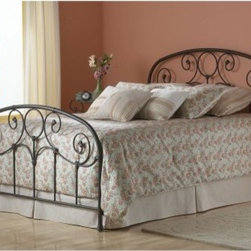 Grafton Bed - The Grafton Bed features prominent scrollwork and decorative banding on its classic headboard and footboard. Heavy iron tubing with softly rounded corners offers timeless appeal while solid castings provide playful character not found in most iron beds. When viewed up close the finish glows with an inner warmth making this bed a perfect match for any warm-toned bedding ensemble. Select your bed size and then choose the headboard alone the headboard with bed frame or the complete bed which includes headboard rails and footboard. Headboard Dimensions: Twin: 39.75W x 1.25D x 52.25H inches Full: 54.75W x 1.25D x 52.25H inches Queen: 61.75W x 1.25D x 54.25H inches King: 77.25W x 1.25D x 54.25H inches Complete Bed Dimensions: Twin: 80L x 39.75W x 52.25H inches Full: 80L x 54.75W x 52.25H inches Queen: 85L x 61.75W x 52.25H inches King: 85L x 77.75W x 52.25H inches About Fashion Bed GroupFashion Bed Group is a Leggett and Platt Company known for its innovative fashion beds daybeds futons bunk beds bed frames and bedding support. Created in 1991 Fashion Bed Group is a large consolidation of three leading bed manufacturers. Its beds are manufactured of genuine brass plated brass cast zinc cast aluminum steel iron wood wicker and rattan. Fashion Bed Group's products are distributed throughout North America from warehouses located in Chicago Los Angeles Houston Toronto and Ennis Texas.