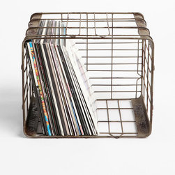 """Wire Storage Basket - If you're anything like me, you're likely to remember that book you need to return to your friend or the dry cleaning that needs to be dropped off after you've already shut the door behind you. Try keeping all your outgoing things in a designated crate by the door. If you have enough space, go one step further and separate items into categories such as """"to return,"""" """"to donate"""" and """"errands."""""""
