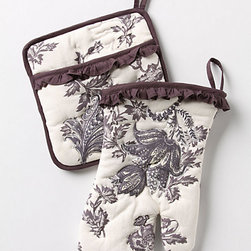 Rococo Potholder and Oven Mitt, Cream - Who couldn't use a fresh set of pot holders? Anthropologie is a great go-to source for cute kitchen goodies, and this ruffled pair with its dark floral print is my current favorite.