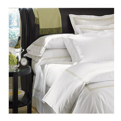"Frontgate - Grande Hotel Duvet Cover - 100% Italian-spun Egyptian Cotton Percale. Generously sized to accommodate pillow-top mattresses up to 17"" deep. Styled after sheets that grace the beds of some of the finest hotels in the world. Machine wash warm on gentle cycle using non-chlorine bleach as needed; wash dark colors separately. Tumble dry on low setting until slightly damp. If you want to recreate the sleep experience of a 5-star hotel, start with the SFERRA Grande Hotel Bedding Collection. Crisp white or ivory linens are framed in tailored, double rows of satin stitching. Woven to a 200 thread-count by master Italian weavers to last through wash after wash.  .  .  .  .  . For best results, pressing is recommended . Fitted sheet in plain white or ivory. Made in Italy by SFERRA."