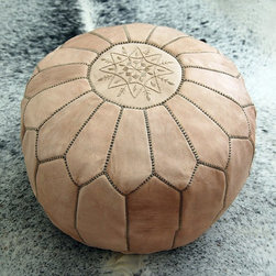Moroccan Leather Pouf by Fez Art - This is what I think of as the original Moroccan pouf — done in leather in a natural tone. Gorgeous!