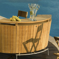 Frontgate - Carre de Lune Bar - Responsibly crafted from beautiful Tropical Forest Trust (TFT)-certified plantation teak wood. Natural, unfinished teak has a fine-sanded finish and will weather to a beautiful silver/gray patina. Rust- and corrosion-resistant 304 stainless steel base support and hardware. Pairs with our Demi Lune II or Sillage Bar Stools. Behind the sleek, modern facade of our Carre De Lune Bar is a thoughtful, utilitarian design.Made for outdoor entertaining, the kiln-dried teak base features two end panels. When opened, the panels support additional bartop space, which unfolds from the center. When closed, the panels provide locked storage.. .  . .