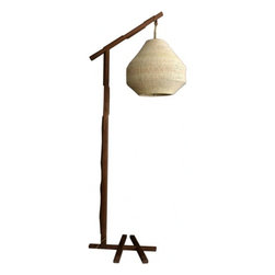 EcoFirstArt - Walnut Floor Lamp - Bring a breezy island feel to your decor with this floor lamp, elegantly crafted by a Brazilian artist. The unique frame is constructed of solid walnut, and the palm shade, whose handwoven shape is inspired from nature. This is organic chic at its very finest, with all sustainable materials and so much style.
