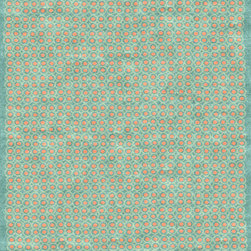 Cuernavaca Rug - The Cuernavaca rug, is composed of an all-over pattern of dots and concentric circles derived from designs representing eyes or seeds. The coral colored silk dots are ringed by light teal circles on a darker teal background. Even though it's geometric, the design is purposefully casual and imperfect.