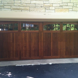 Various Installs - CHI 5430A Cedar Carriage house insulated garage door with 2-2 piece Arched windows installed on historic home in Highland Park.  Call Overhead Garage Door at 1-888-459-3720.